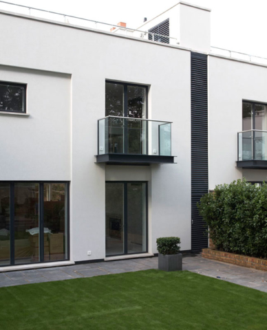 Rear aspect of property, showing balcony of stainless steel and glass panels