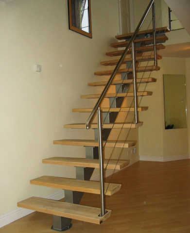 Open plan wooden stairs with stainless steel handrail