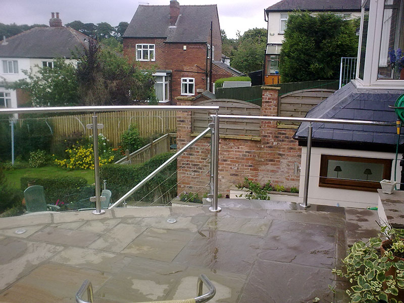 Stainless steel handrail, with glass panels