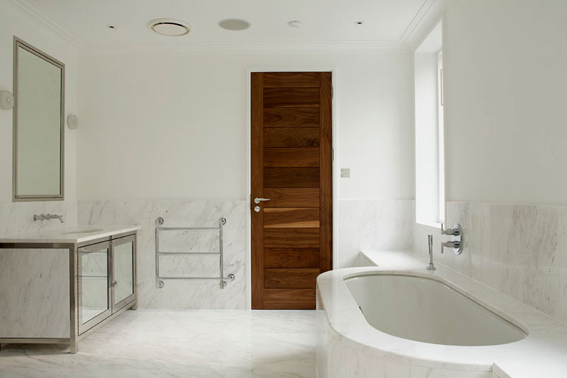 Bathroom, with stainless steel trim around cupboards and mirror
