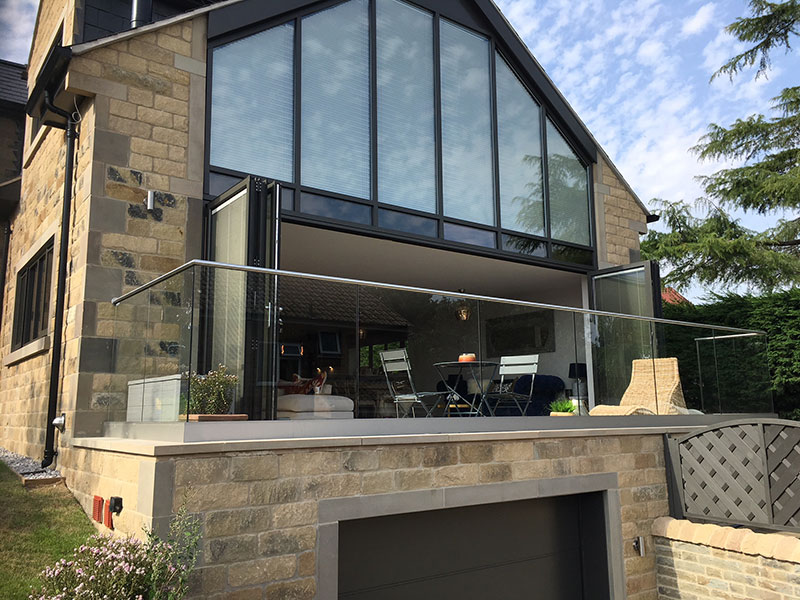Rear of house with veranda, glass panels with stainless steel handrail