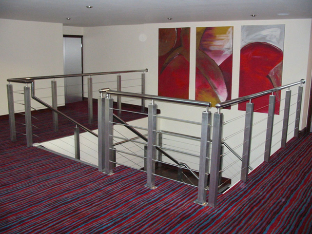 Staircase landing, with stainless steel hand rails and balustrade