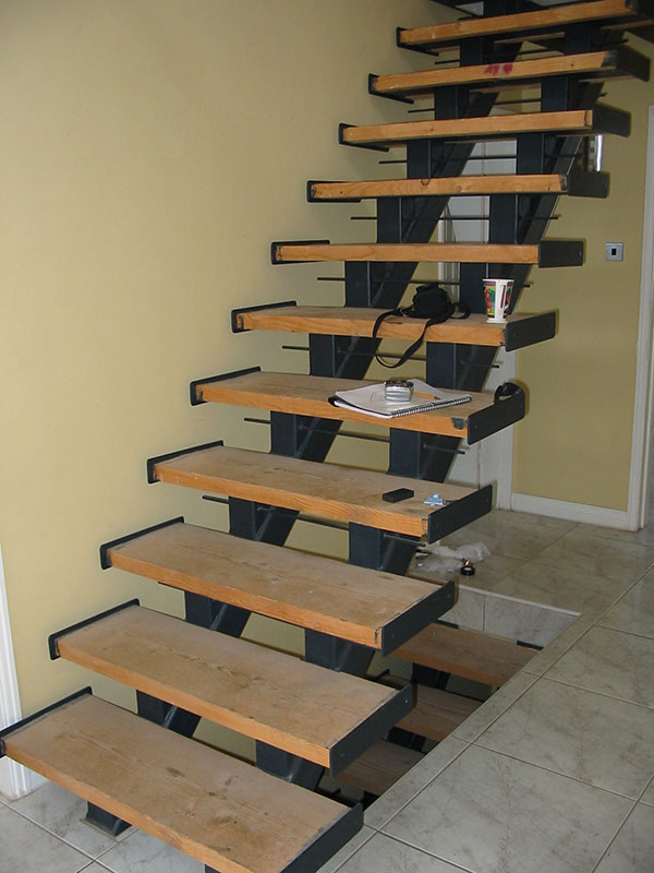 Wood and mild steel open plan stairs